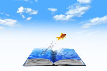 Golden fish jumping across water book, conceptual idea