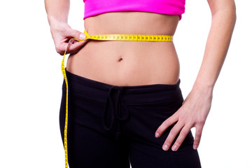 a slim girl measuring her waist - closeup, isolated