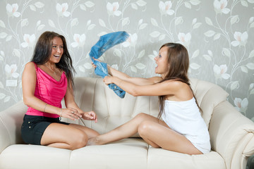 Happy girls playing with clothes