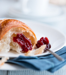Close up of croissant with sour cherry jam