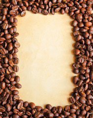 Coffee beans as frame with old paper background for notes
