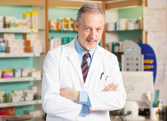Confident pharmacist in his shop