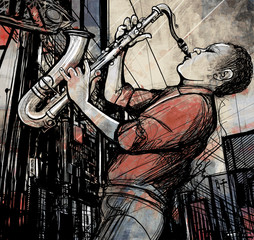 Foto op Canvas Muziekband saxophone player in a street at night