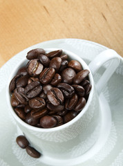 coffee beans in white cup closeup