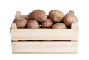 raw potatoes in a wooden box isolated on white