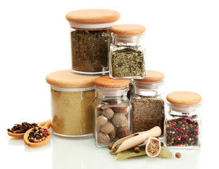Poster Kruiden 2 jars and wooden spoons with spices isolated on white