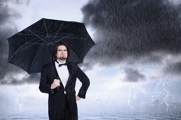 Man Holding Umbrella in the Rain and Frowning