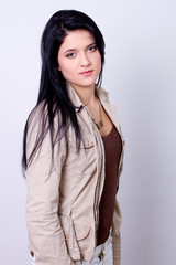 portrait of a young fashion woman against gray background