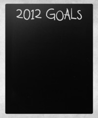 """2012 goals"" handwritten with white chalk on a blackboard"