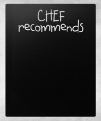 """""""Chef recommends"""" handwritten with white chalk on a blackboard"""