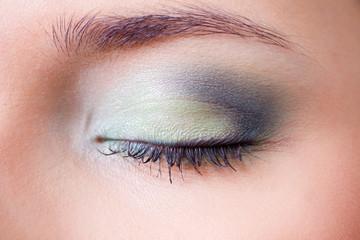 closeup female eye with makeup