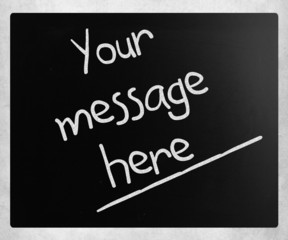 """""""Your message here"""" handwritten with white chalk on a blackboard"""