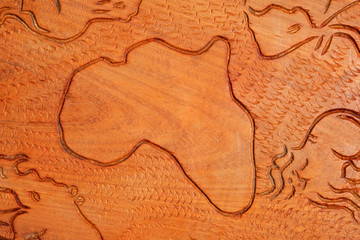 Shape of the African continent and animals carved in wood