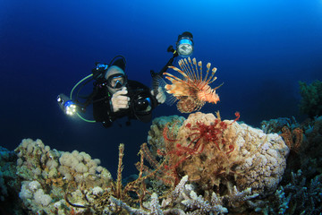 Scuba Diver takes an underwater photo of a Lionfish