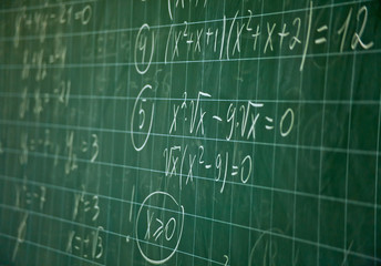 Green blackboard with solution of the mathematical equation