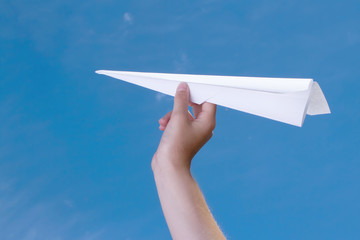 child holding a paper airplane