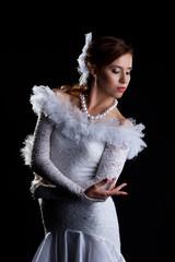Pretty woman portrait in white flamenco costume