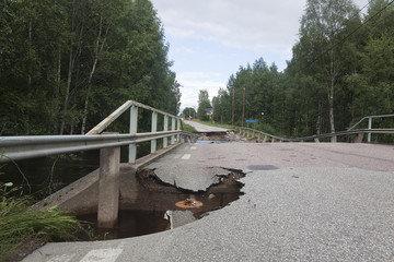 Broken asphalt on bridge caused by heavy rain, Sweden