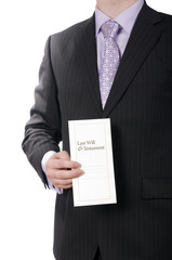Man in suit presenting a last will and testament