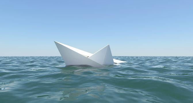 White paper boat is sinking in the sea water