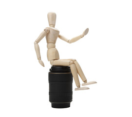 Wooden mannequin and photo lens