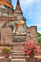 Ancient buddha statues with blue sky, Thailand