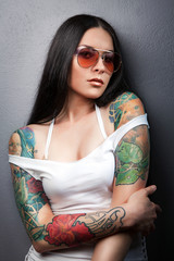 Beautiful sexy glamorous girl with tattoos.