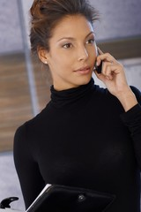 Attractive businesswoman talking on mobile