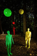 strange forest people playing with colorful balls