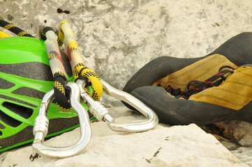 Detail of climbing helmet, carabiner and shoes
