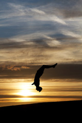 Fototapete - silhouette of gymnast in sunset