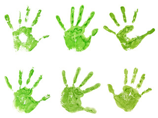 Conceptual green painted hand shape or print isolated on white