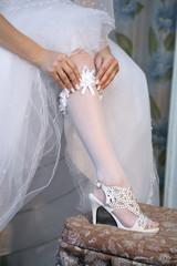 Foot of  bride.