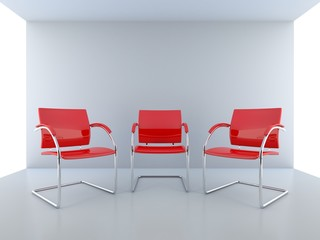 Three red seats in an empty room
