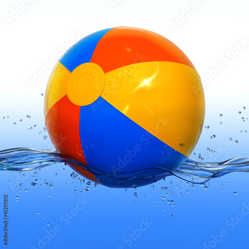 """Beach Ball In Water colorful beach ball floating in water"""" stock photo and royalty"""