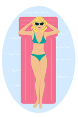 Young blond woman sunbathing on pink airmattress