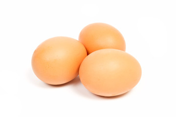 raw chicken eggs isolated on white background