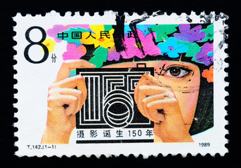 Stamp printed in China shows the 150 anniversary of photography