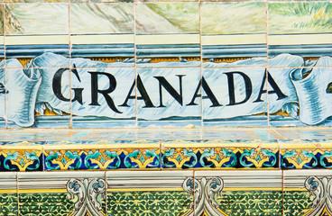 Granada sign over a mosaic wall