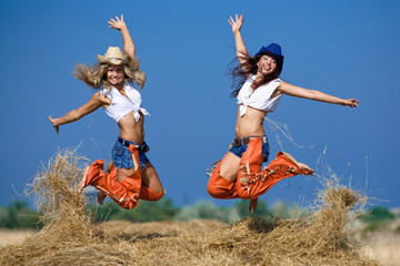 Girls jumping at the field