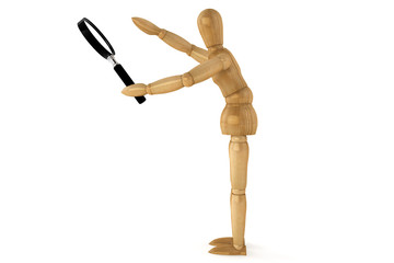 Wooden dummy with magnifying glass