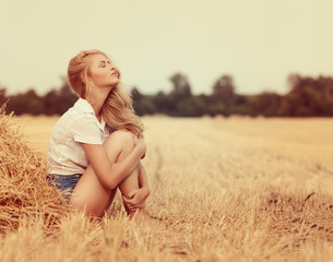young beautiful woman on field