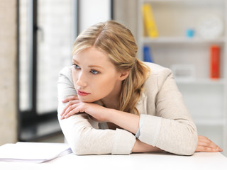unhappy woman in office