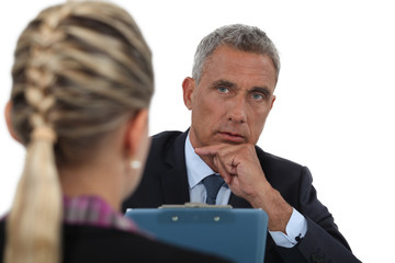 Businessman interviewing a young woman