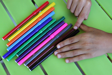 Spoed Fotobehang Manicure Children' s hands and colored crayons, isolated