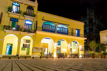 Outdoors cafe at night in Old Havana