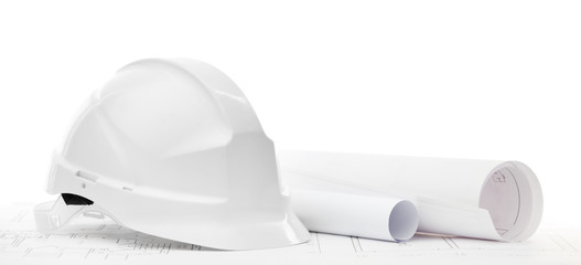 White hard hat near working or engineering drawings