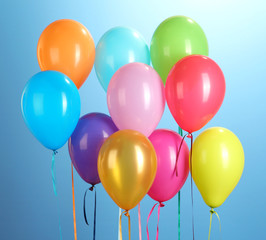 colorful balloons on blue background close-up
