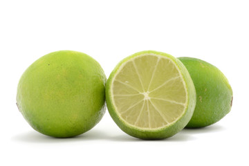 Three fresh limes isolated over white background