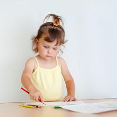 Charming toddler draws. Little girl draws